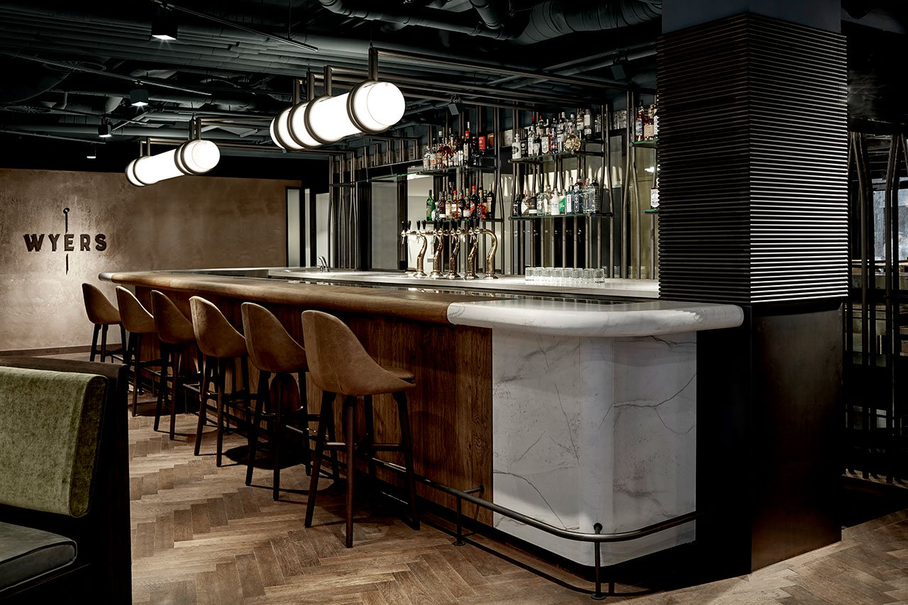 A White Marble Bar And Exposed Pipes Are The Stars In A