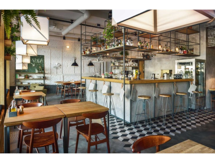 A Trendy Polish Bar with Classic Mid-Century Bar Stools