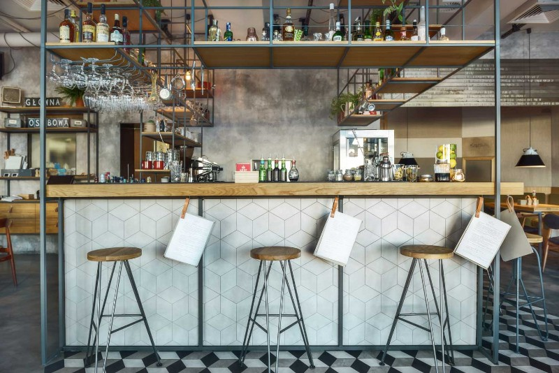 A Trendy Polish Bar with Classic Mid-Century Bar Stools